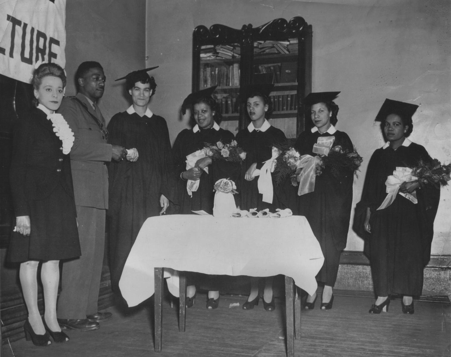 Viola Desmond speaking at graduation, ca. 1945. Wanda Robson Collection. Beaton Institute, Cape Breton University.