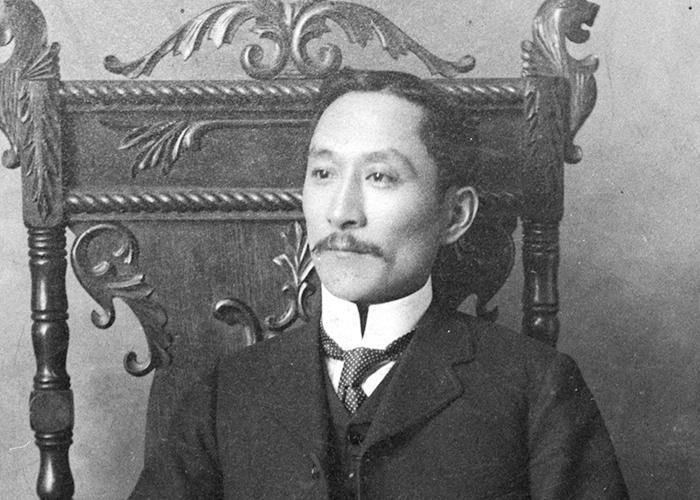 Won Alexander Cumyow seated in an ornate chair.
